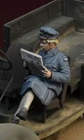 WWII British WAAF girl reading a newspaper